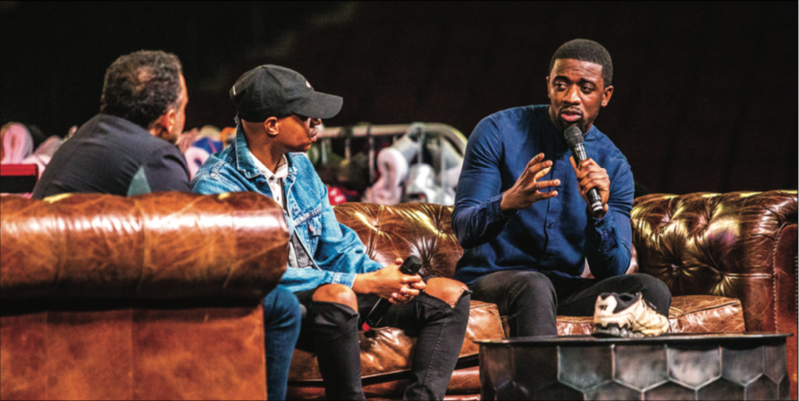 DISCUSSION — Emmanuel Ntibonera (right) shared his story and spoke about how Kick'n It was formed. Photo Credit: Michela Diddle