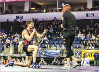 PROPOSAL — After winning the  nals of the NCWA tournament, Josh Ferenczy dropped to a knee and popped the question. Photo Credit: Dana Podell