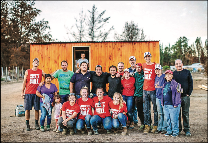 HELPING HANDS — LU Send Now team is photographed with the Chilean family they helped build a house for following destruction from local  res. Photo Provided