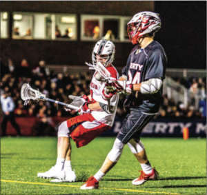 UNDEFEATED — The Flames lacrosse team improved to 5-0 in midnight games. Photo Credit: Caroline Sellers