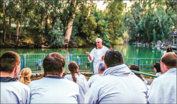 ADVENTURE — Mat Staver taught students before baptizing some in the Jordan River. Photo Credit: Sarah Rodriguez