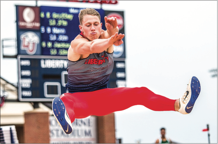 JUMP — Senior decathlete Zach Davis  finished second overall with a  final decathlon score of 5,819, and he won the discus and javelin events. Photo Credit: Kevin Manguiob