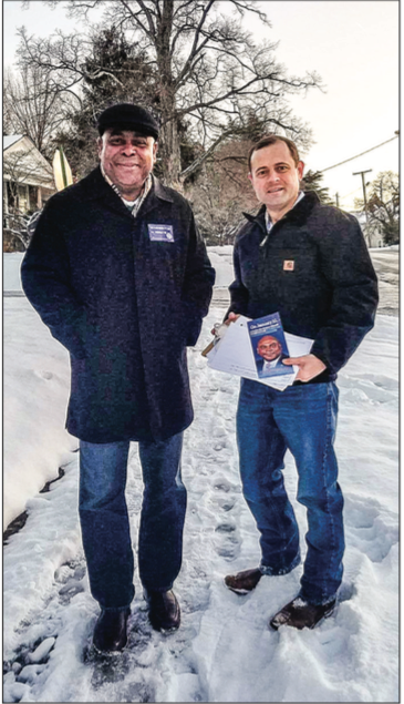 DOOR-TO-DOOR — Volunteers campaign for candidates in the Jan. 10 special election. Photo Provided