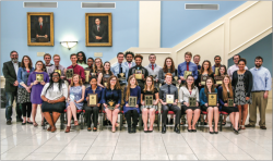 AFFIRMING SUCCESS — Students and coaches on the debate team posed with their various awards they received throughout their season. Photo provided