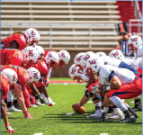 snap and clear — The offense defeated the defense 59-24 in the Liberty Flames football spring game April 15.  Photo Provided: Leah Seavers