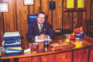 Dr. Jerry Falwell sits in his office. Date and photographer unknown.