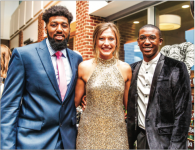 AWARDS — Basketball players A.C. Reid (left) and Lovell Cabbil (right) pose alongside Flamespy co-host Anna Willey. Photo Credit: Caroline Cummings