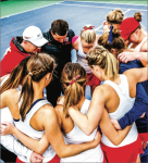 UNITY — The Liberty women's tennis huddled together for prayer before a match. Photo Credit: Joel Coleman