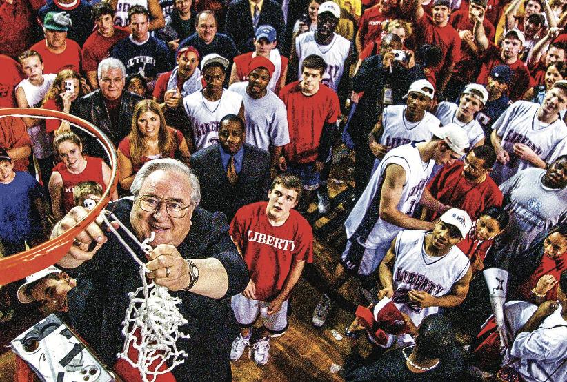 Jerry Falwell Sr. cuts down the net. Photo Credit: Les Schofer