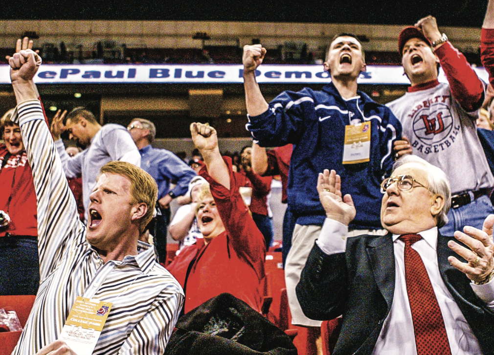 onathan Falwell and Jerry Falwell Sr. cheer on the Lady Flames basketball team in the 2nd round of the 2005 NCAA tournament. Photo Credit: Les Schofer