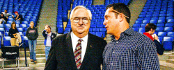 Shane Pinder talks with Jerry Falwell Sr. at a volleyball match versus Charleston Southern.