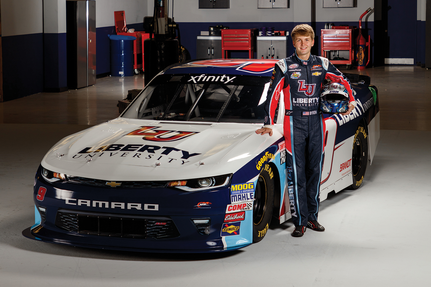 Liberty University freshman William Byron stands with the new Liberty University No. 9 Chevy Camaro he will drive during his rookie season with JR Motorsports (JRM) on the Xfinity Series.
