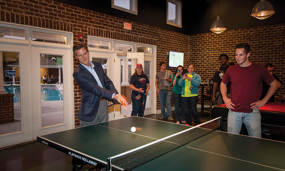 President Jerry Falwell, Jr. plays pingpong with students in the newly renovated David's Place.