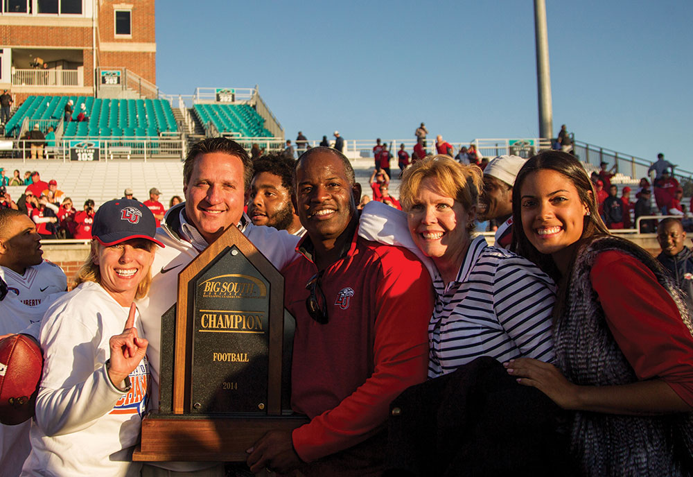 Liberty athletics leaders and their families celebrate a conference win.