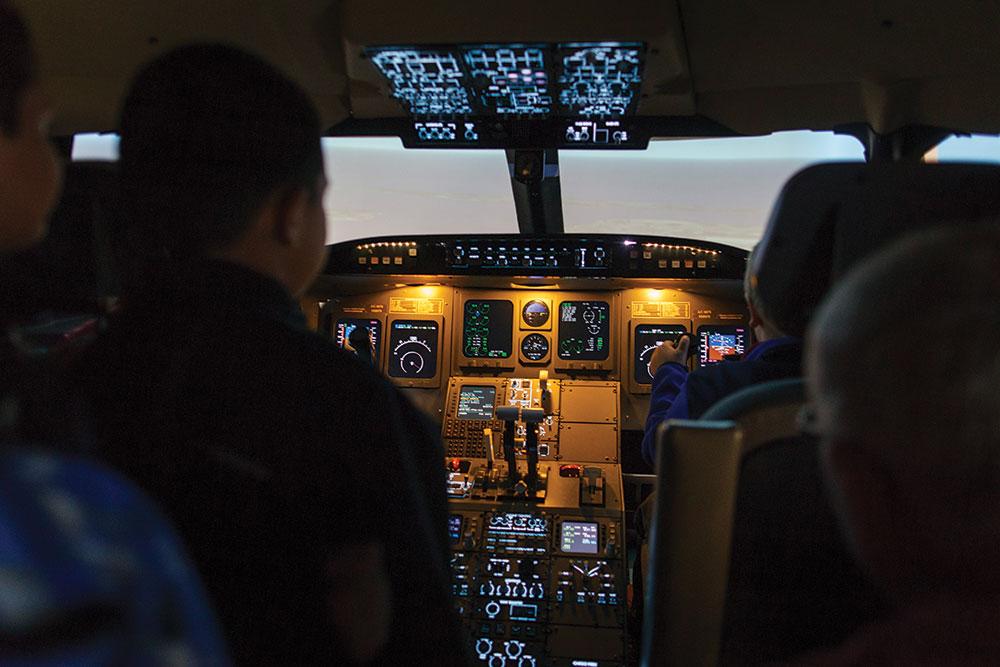 Students train on a flight simulator at the School Aeronautics.