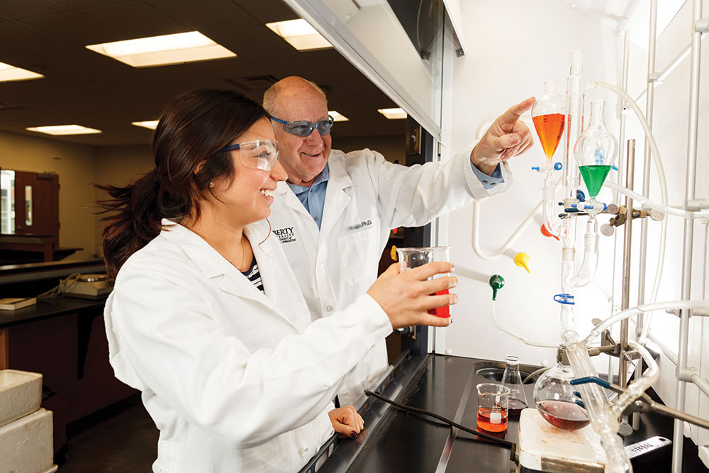 Biology student and professor work together at Liberty.