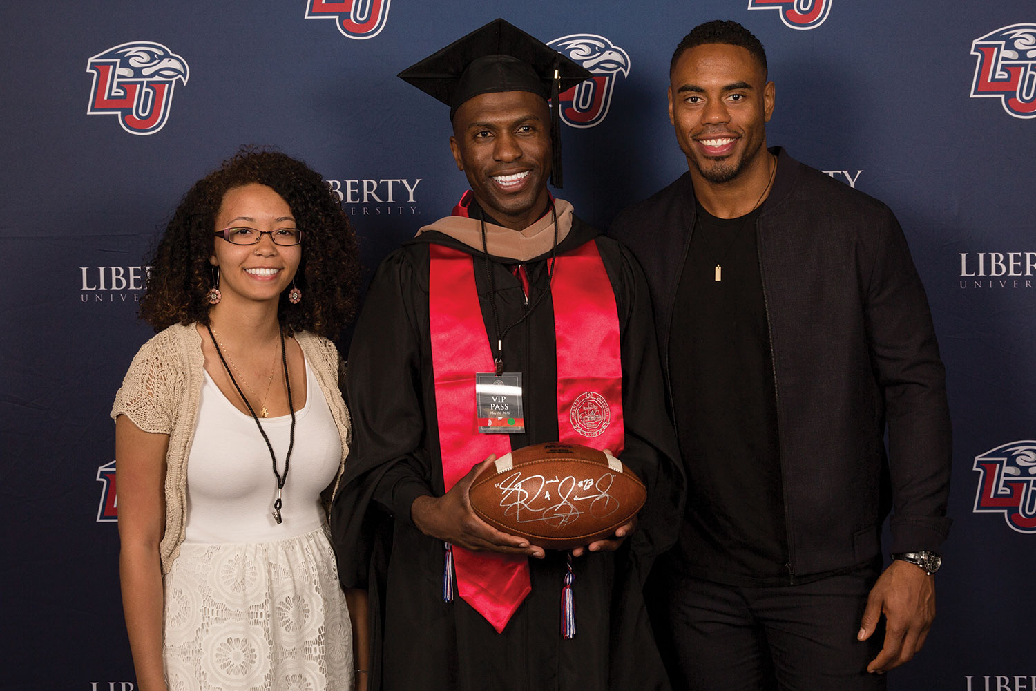 One lucky graduate caught the football thrown by speaker Rashad Jennings of the New York Giants.