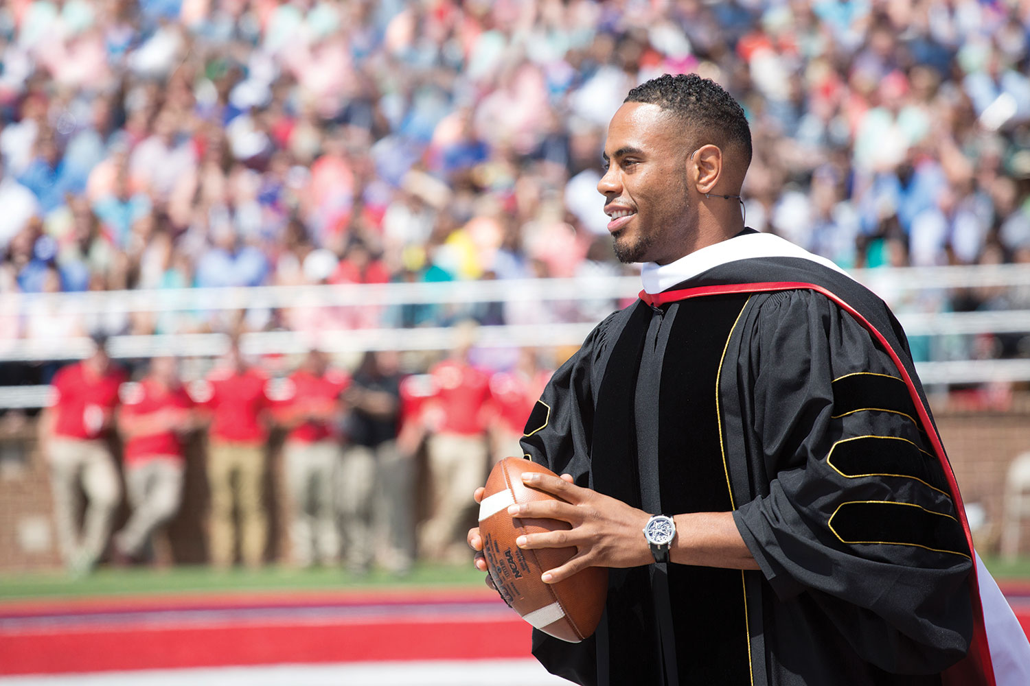 Rashad Jennings threw an autographed football into the crowd of graduates after his speech.