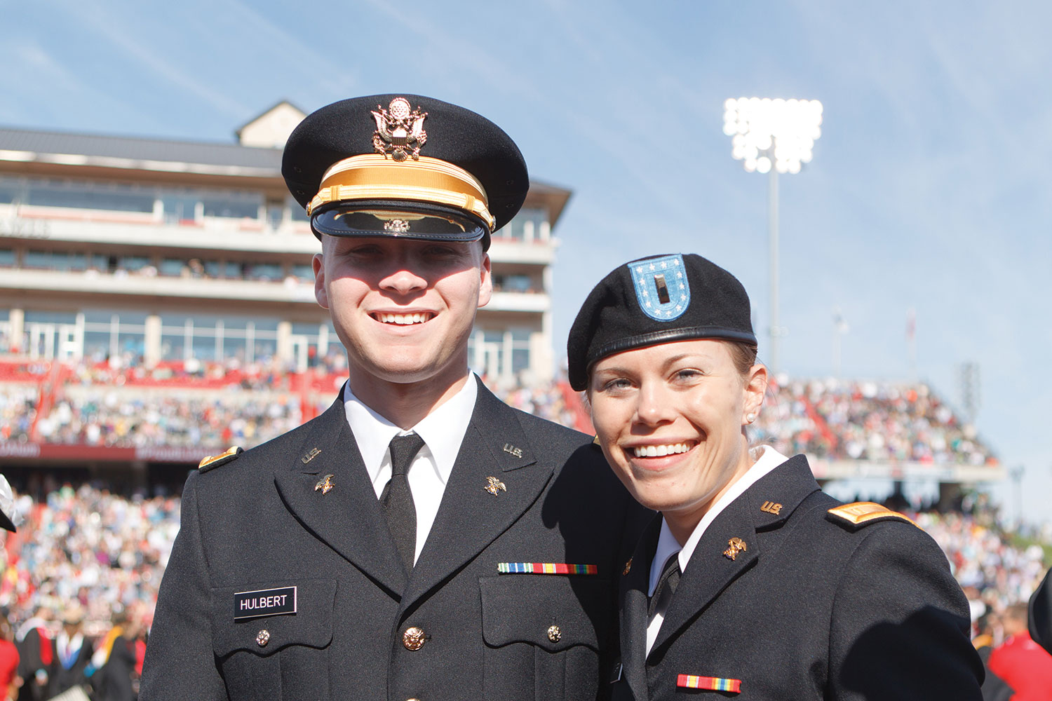 Two military graduates celebrate Commencement.