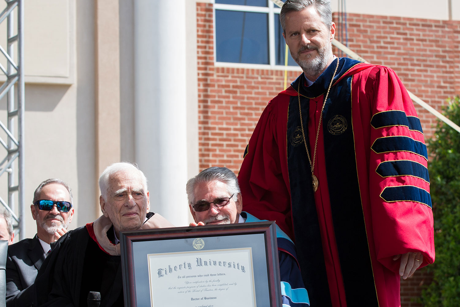 George Rogers, World War II veteran, is awarded an Honorary Doctor of Business.