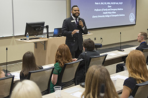 Troy Burnett, associate director of Student Services, leads orientation session.