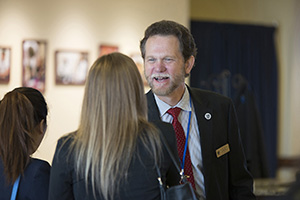 Peter A. Bell, DO, dean of LUCOM, greets new student.