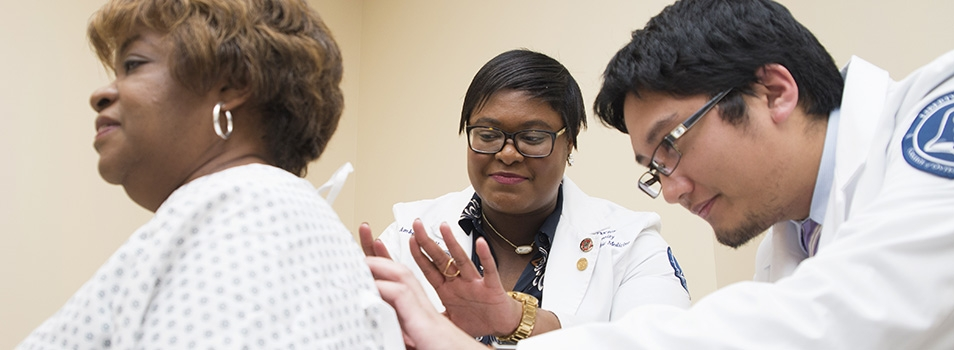 Liberty osteopathic medical students examine a LUCOM standardized patient.
