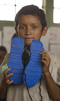 Shoe donation to child in Guatemala