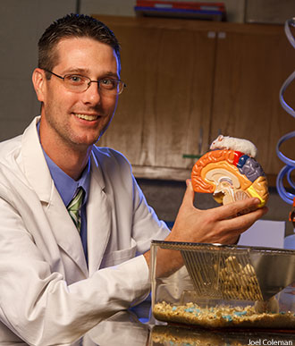 Liberty biology professor Dr. Gary Isaacs in research lab.