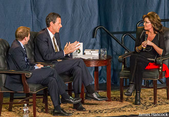Liberty University President Jerry Falwell, Jr. speaks with former Gov. Sarah Palin during Liberty University Convocation.