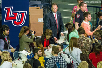 Sarah Palin signs copies of her book for Liberty University students.