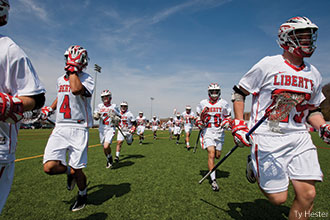 Flames Lacrosse takes the field.