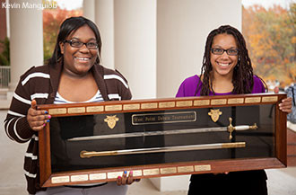 Liberty University debaters Vida Chiri and Meagan Edwards with the coveted USMA tournament sword.