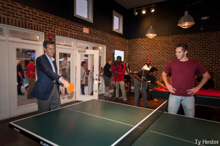President Jerry Falwell, Jr. plays pingpong with students in David's Place.