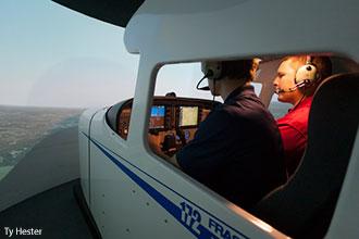 Liberty aeronautics students practice in a flight simulator.