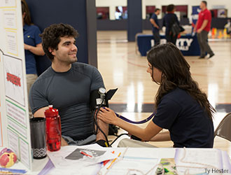 Liberty nursing student gives heart screening.
