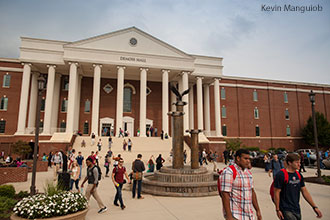 Liberty University students pass in and out of DeMoss Hall.
