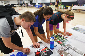 Liberty University students sign up for Live Healthy Liberty at Wednesday's Health Fair.