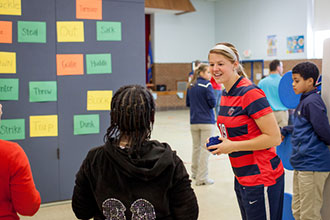 Athletes play reading-related games with students.