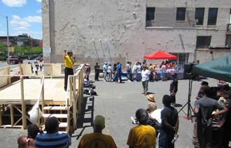 The Gospel message is preached during an evangelistic outreach event in Baltimore.