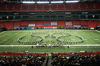 Liberty's Spirit of the Mountain Marching Band performs in the Georgia Dome.