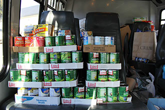 Liberty brings a large donation to the Blue Ridge Area Food Bank.
