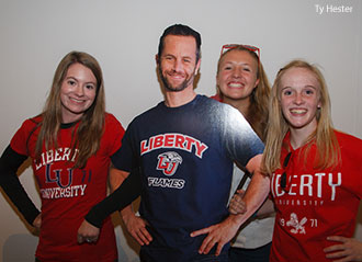 Liberty students pose with a cutout of Kirk Cameron during a premiere of Saving Christmas.