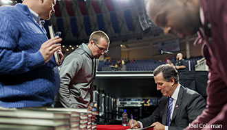 Rick Santorum signs books for Liberty students after his message.