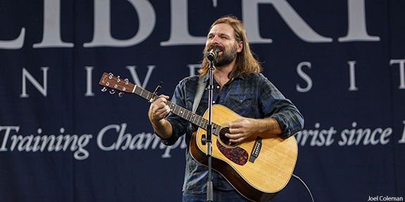 Mac Powell, lead singer of Third Day, performs at Convocation in the Vines Center.