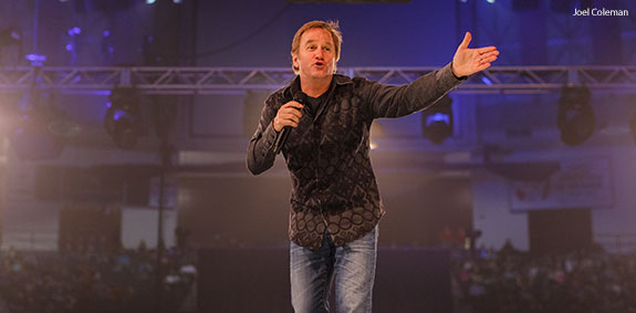 Comedian Brad Stine makes students laugh during Liberty University's Convocation on Feb. 23.