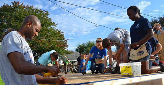 Students from Liberty's Habitat for Humanity club work to build a house for a local Lynchburg family.