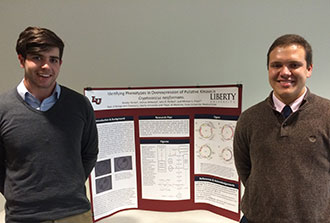 Liberty students Nocolas Terreri and Josh Sellwood with their research poster.