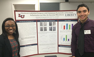 Liberty University students Dominique Richburg and Jorge Tovar present at the VAS.