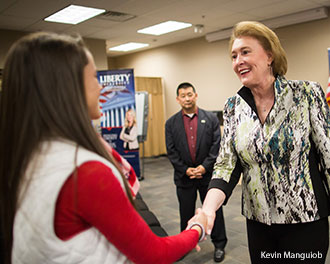 Janet Huckabee greets students at Liberty University.